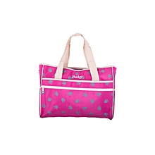 Pink Multifunctional Diaper Bag with a Changing Mat .