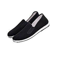 Black Unisex Canvas Shoes With A White Rubber Sole.