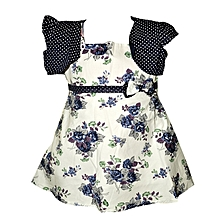 White sleeveless cotton dress with navy blue floral prints & navy blue jacket