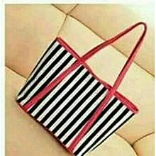 woman striped leather classy handbag