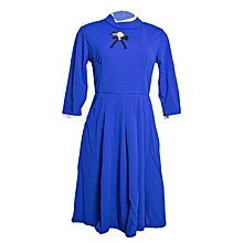 Blue Dress With Pockets And Lace At Neck And Hand.