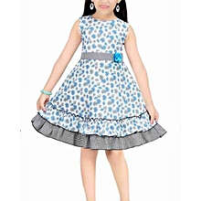 Sleeveless blue flowered cotton dress with frill at the botton