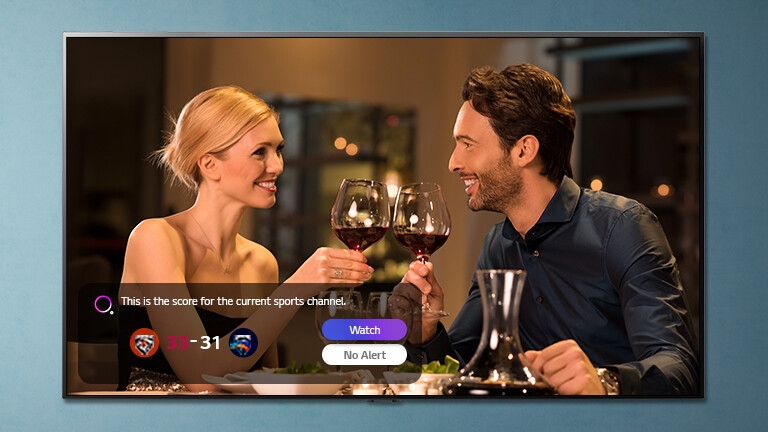 A man and a woman clinking glasses on a TV screen while sports alerts being notified