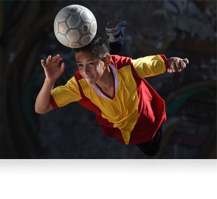 D7200 photo of a soccer player hitting a soccer ball with his head