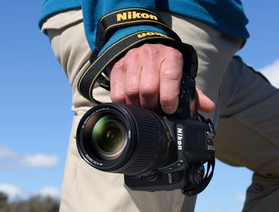 Photo of a person's torso with the camera in hand