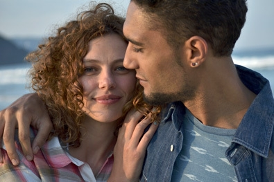 Photo of a woman and man close up at the beach