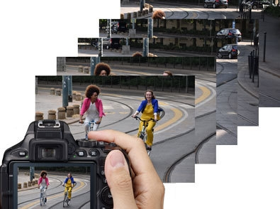 Photo of a Nikon D5600 DSLR with an image of two women bike riding on the LCD and a group of shots showing fast FPS shooting