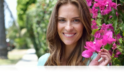 D5300 photo of a woman holding a pink flower