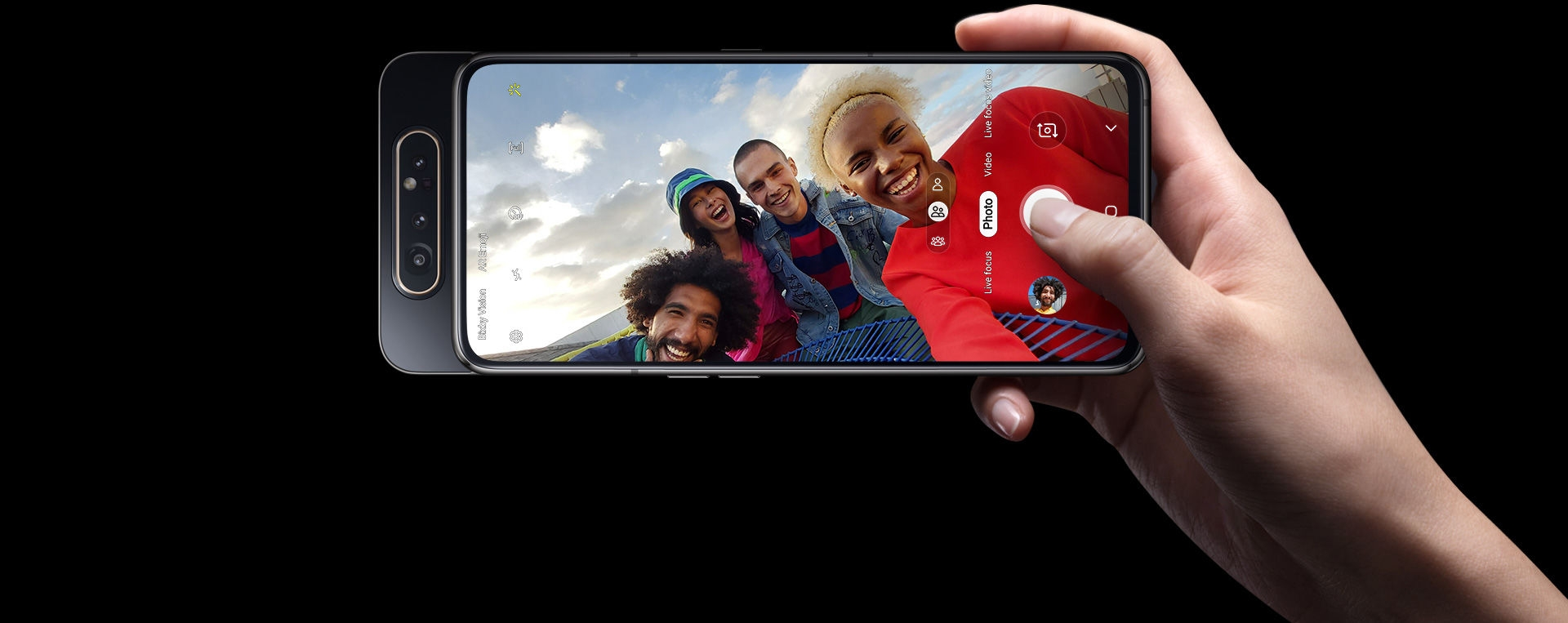 Right hand taking a group selfie with Galaxy A80's 48MP Rotating Camera.