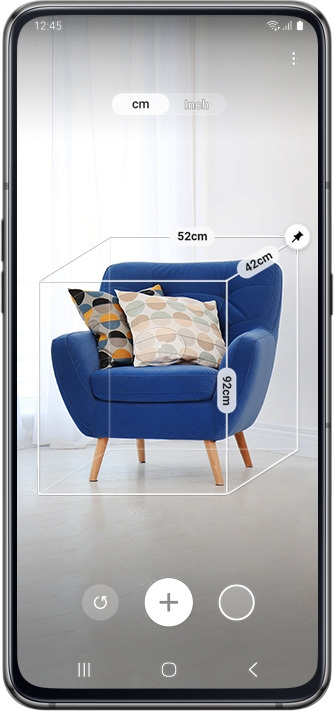 Galaxy A80 scanning a blue chair onscreen to calculate measurements.