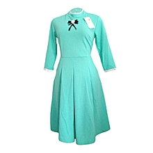 Green Dress With Pockets And Lace At Neck And Hand.