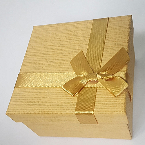 Small Square Light Beige Gift Box With A Bow Tie Ribbon