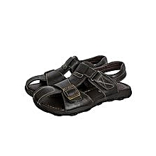 Black Closed Toe Sandals With A Buckle And Velcro Straps