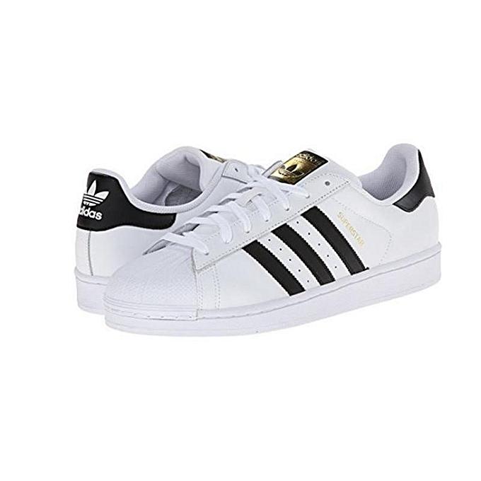 Men's Superstar Foundation Fashion Sneaker, White/Collegiate Navy/Metallic/Gold, 8.5 M US